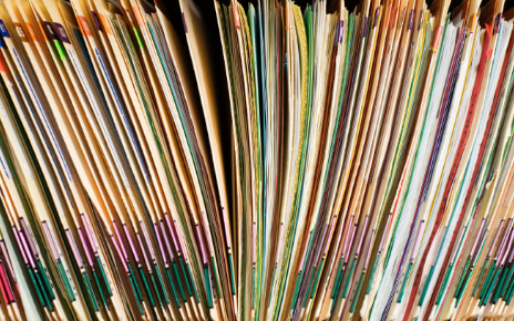 A stack of medical record files.